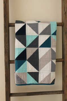 grey and blue geometric quilt -- I love the machine quilting pattern on each square.