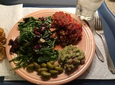 Trader Joes stuffed Pepper with side salad, guacamole & TJ's world's best olives.
