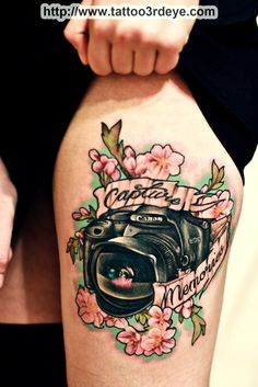 i like the look of the camera in the tattoo