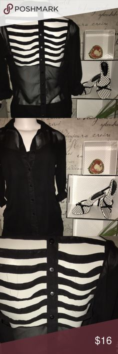 Sheer black top with cut outs on the back Super classy and fun! Sheer black shirt with cut outs on the back. Button details on the shirt tail. The picture doesn't do this shirt justice. I had to pick it up when I saw it. Love it! I accept reasonable offers and I offer a bundle discount.  Let me know how I can help you get this classy number into your personal closet. ✨ Live 4 Truth Tops Button Down Shirts