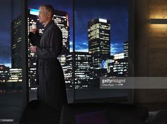 Stock Photo : Man drinking coffee and looking at night cityscape