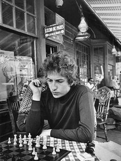 "Bob Dylan playing chess in Woodstock, N.Y., 1964. Photo by Daniel Kramer. "" Ha! I've been on that sidewalk (it's a small town). """