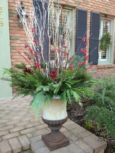 December 1st ... time to set the mood for the holiday!  Here's my annual winter planter except this year I added platinum painted branches!  They sparkle at night from the porch lights!  Happy holiday season everyone!