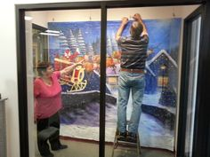 """A little higher on the right, Bob,"" says Kathleen as they set up the Art Club's Christmas display -"