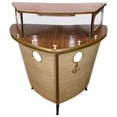 Midcentury Ship Form Nautical Themed Illuminated Bar, circa 1950s | From a unique collection of antique and modern dry bars at https://www.1stdibs.com/furniture/storage-case-pieces/dry-bars/