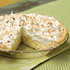 Coconut Cream Pie Ingredients: 1/2 (15-ounce) package refrigerated piecrusts 1/2 cup sugar 1/4 cup cornstarch 2 cups half-and-half 4 egg yolks 3 tablespoons butter 1 cup sweetened flaked coconut 2 1/2 teaspoons vanilla extract, divided 2 cups whipping cream 1/3 cup sugar Garnish: toasted coconut.