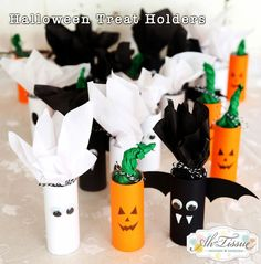 Get Your DIY on - Kids Halloween treat holders made from recycled toilet paper rolls.
