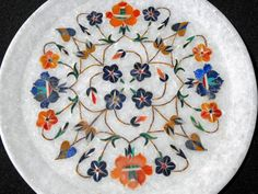 Inlaid Marble: we have a similar piece (like the walls of the Taj Mahal)