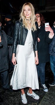 Pair a leather jacket and slip dress with sneakers like Karlie Kloss.