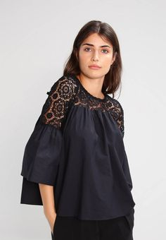 """Navy London. KRISS - Blouse - black. Fit:large. Outer fabric material:100% cotton. Our model's height:Our model is 69.5 """" tall and is wearing size 10. Pattern:plain. Care instructions:do not tumble dry,machine wash at 30°C. Fastening:..."""