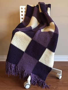 You will love the woven texture of this lavender throw! This throw is worked in one piece, working with six balls of yarn at one time. It is constructed with the moss stitch, a series of single crochet and chain stitches. The bold blocks of colour make for endless colour combinations.