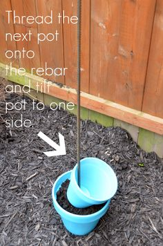 Pound rebar 2 feet into ground and thread pots. Plant and have a pretty vertical garden. Pound rebar 2 feet into ground and thread pots. Plant and have a pretty vertical garden. Bird Bath Garden, Diy Bird Bath, Garden Planters, Diy Garden Projects, Garden Crafts, Outdoor Projects, Topsy Turvy Planter, Vertical Planter, Plantar
