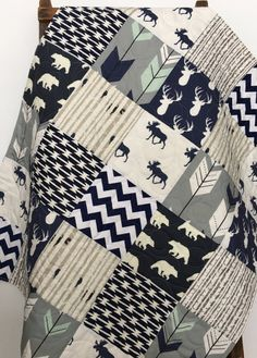 Baby Quilt Boy, Navy Gray Crib Bedding, Woodland Nursery Boy, Deer Baby Bedding, Navy Gray Nursery, Chevron Baby Quilt, Crib Bedding. This adorable baby quilt features a collection of fabrics I love. This listing is for a baby quilt. It features 3 total layers and has light to medium weight. The middle layer consists of warm and natural 100% cotton batting. Entire quilt will be machine quilted using free motion quilting. Backing features navy chevron print (picture #5).  Pick from the drop…