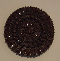Necklace circular charm, Brown in color, very heavy piece, Vintage style. by Deannaroserichardson on Etsy