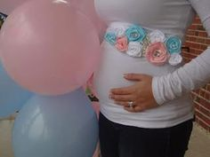 Absolutely adorable sash to wear for a gender reveal party with both white pink and blue flowers. Perfectly accentuate a pregnant bump! I love this shot with the pink and blue balloons as well