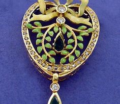 PENDANT: yellow gold, 34 diamonds 0,35 ct., 2 rubies 0,46 ct. and enamels. size: 40 x 24 mm. 01MP0384-R