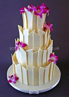 www.scrumptiouscakes.co.uk (582) - 4 tier white chocolate shards wedding cake with fresh pink orchids.