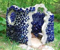 bottle mosaic garden shed - would take a lot of Skyy bottles to make this!