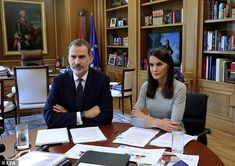 King Felipe, 52, and Queen Letizia, 47, appeared business-like as they spoke to members of...