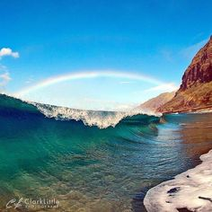 Somewhere over the rainbow…there's a wave…love this photo by Clark Little Photography