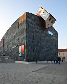 This is actually an art installation at (on?) the Vienna Museum of Modern Art. By Erwin Wurm: House attack - Vienna - Crazy Architecture From Around the World Unusual Buildings, Interesting Buildings, Amazing Buildings, Modern Buildings, Architecture Design, Amazing Architecture, Building Architecture, Architecture Artists, Architecture Interiors