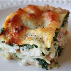 Lobster Lasagna  NGREDIENTS: 1 package no cook lasagna noodles 1 package frozen chopped spinach 3 cooked, lobster tails , diced 4 cups shredded mozzarella cheese 2 pints ricotta cheese salt and ground black pepper to taste Alfredo Sauce: