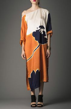 This is our Peony print silk kaftan worn by night with high heels and accessories. www.ddoo-collective.com