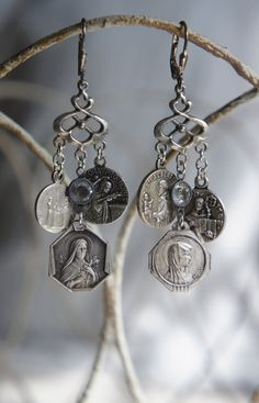 Vintage assemblage earrings with vintage religius medals by frenchfeatherdesigns