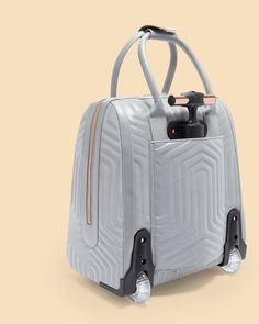 Reflective quilted bow travel bag - Silver | Bags | Ted Baker