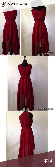 Wine High-Low Dress Pretty high-low dress in a rich wine color. Super lightweight and would be perfect for a number of occasions. The bottom half of dress is lined but the top is a bit sheer so it would look cute with a bandeau or cute bra. No flaws, great condition. From shoulder to the short front is 31.5 inches long, shoulder to long back is 49 inches. Dress is 16.5 inches across pit to pit. No flaws, like New! Sans Souci Dresses High Low