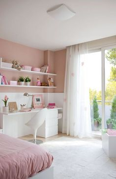 A gorgeous pink themed bedroom but not too over powering! The shelves on the wall are a great space saver and I love the retro looking chair