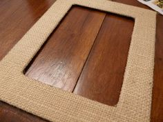 Cover photo mats with fabric or burlap to give them a new look