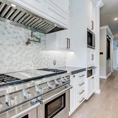 Pictured: our popular Droplet designed tiles from Chapter 1 Suite Glass, in Diamond color - 10.375' x 10.25' (10119) Photo courtesy of ALine Designs LLC.