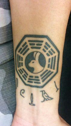 Kenny's LOST tattoo.