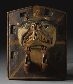 Northwest Coast polychrome wood frontlet carved in relief with a voracious animal, probably a wolf.