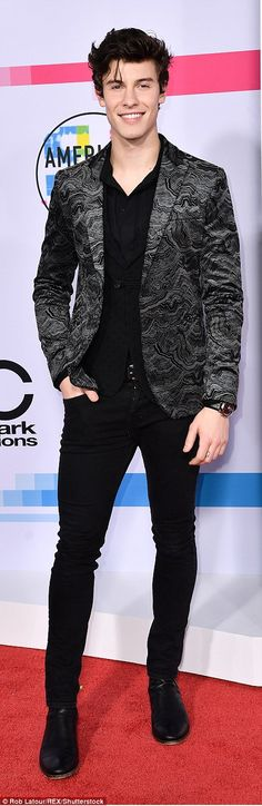 Handsome: Shawn Mendes (l) and Riverdale star KJ Apa (r) both reached for patterned blazers and paired it with black trousers by Emporio Armani