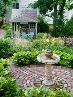 Even+a+small+fountain+or+birdbath+lends+a+soothing+sound+or+draws+birds+and+butterflies.+Petite+water+features+can+also+act+as+a+charming+focal+point,+like+this+birdbath+centered+in+a+small+circular+brick+patio.