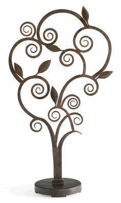 EDGAR BRANDT (1880-1960) A Wrought-Iron Tree, circa 1925 43½ in. (110.5 cm.) high, 24¼ in. (62 cm.) wide stamped E BRANDT