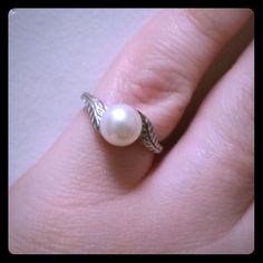 Pearl Sterling Silver ring A very pretty little ring. Little bit of detail in the sterling silver. Jewelry Rings