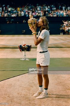 Bjorn Borg kisses the Championship Trophy after beating Ilie Nastase, 6-4, 6-2, 9-7, to become Wimbledon men's singles champion.