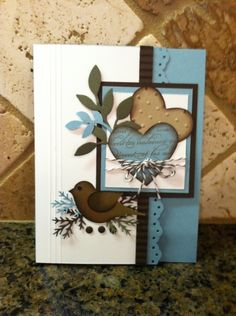 Stampin' Up! ... handmade card .... two step punched bird on a nest of leaves ... die cut hearts ... browns with soft blue and vanilla ... lovely card