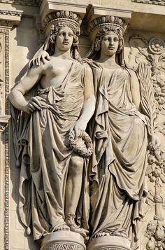 Two assembled caryatids supporting the pediment of the Pavillon Richelieu, Louvre, Paris.