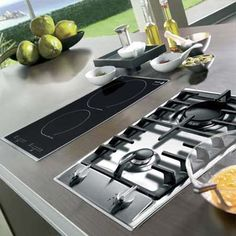 two-burner induction cooktop next to 2 burner gas hob