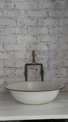 Enamel basin & copper tap