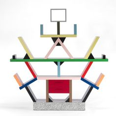 The Carlton bookcase was designed by Ettore Sottsass for Memphis Milano in 1981. This outstanding piece in bold colours features a wood, metal and plastic structure in mint vintage condition,