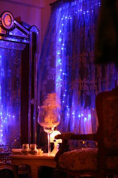 String lights diffused with lace or tulle fabric create a soft lighting element.