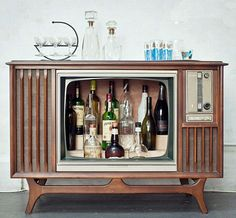 Vintage television consoles can be reclaimed and converted in liquor cabinet style home bars that give new meaning to entertainment centers :D .. More re-purposed TVs at http://homebars.barinacraft.com/post/32666606235/old-tv-conversions-to-home-bars #cabinets