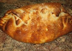 This is a great, tasty big calzone! I used one can of Pillsbury pizza dough (about ounces) which is a great way to make this calzone quickly. I made one large calzone which was divided to serve two people. Calzone Recipe Pillsbury, Stromboli Recipe, Pizza Dough Calzone Recipe, Cheese Calzone Recipe Ricotta, Homemade Calzone, Pillsbury Dough, Cheese Sausage, Quesadillas, Pizza