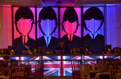 Groovey British Invasion Theme for galas and events. Beatles bar backdrop and British flag lit agam bars.
