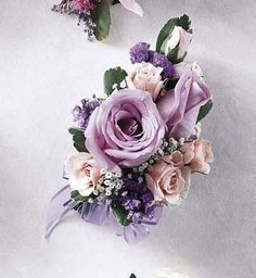 MY COLORS:PURPLE, GOLD & IVORY.Mauve and light pink shades in a corsage to pin on. Change it to a wrist corsage with a velcro wristlet, or put it on a pearl or decorative wire wristlet. Boutonnieres, Prom Corsage And Boutonniere, Flower Corsage, Corsage Wedding, Wedding Bouquets, Bridesmaid Bouquet, Bridesmaid Dresses, Flowers Today, Prom Flowers